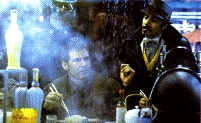 Gaff talks to Deckard at the Noodle Bar in Blade Runner