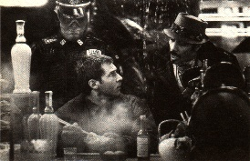 Gaff speaks to Deckard at the Noodle Bar